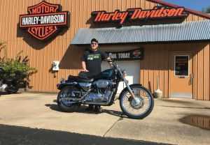 Sam and his first Harley-Davidson motorcycle!