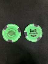 Green and Black Poker Chip